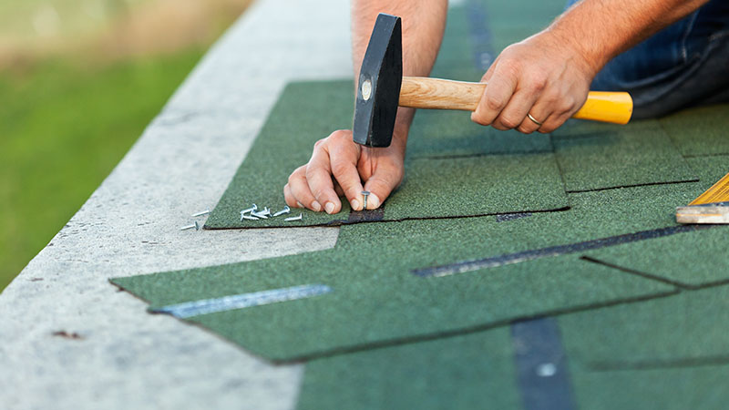 Replacing hunter green shingles on a roof