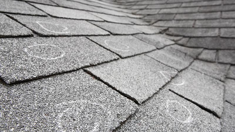 Hail damage marked on shingle roof